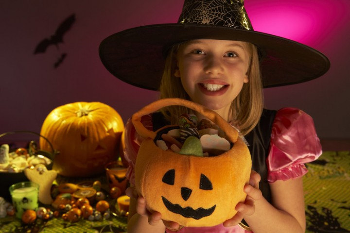 girl holding halloween candy