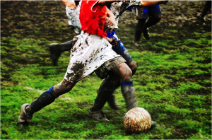 Soccer players in mud