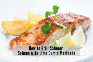 filet of grilled salmon with lemon wedges