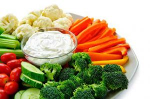precut trays of fresh vegetables and dip are healthy workplace snacks