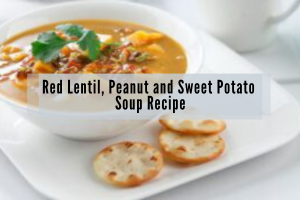 bowl of lentil sweet potato soup in white bowl with crackers on white plate