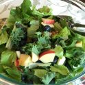 Glass bowl kale, apple, berry salad
