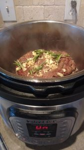 Instant pot with beef roast