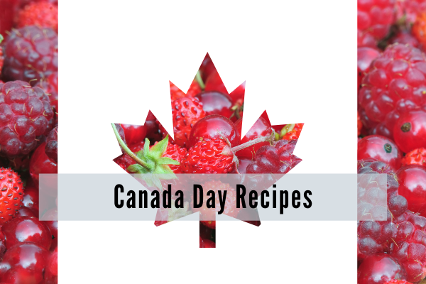a canadian flag where the red bars and maple leav are made from red fruits