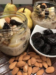 jar of overnight oats with dried plums and pears