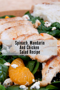 green spinach salad with mandarin oranges, grilled chicken and goat cheese