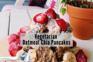 stack of pancakes with fresh strawberries, bananas and chia seed sauce