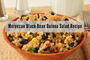 rustic wooden bowl of quinoa black bean and corn salad garnished with fresh herbs