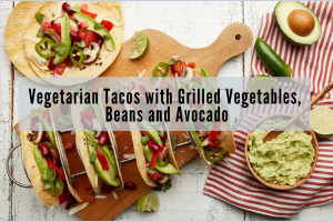 wooden tray with soft tacos filled with avocado and beans