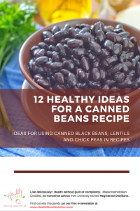 bowl of black beans and bundle of cilantro on a blue cloth