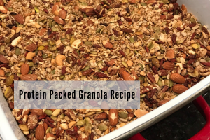 Red ceramic pan filled with nut and seed filled granola