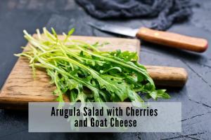 pieces of arugula on a cutting board