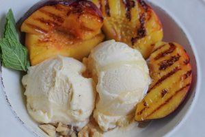 grilled peaches served with vanilla ice cream