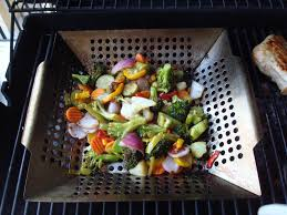 mixed vegetables cooking in a grill wok
