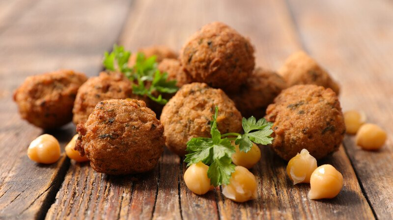 falafel balls garnished with chick peas and parsley