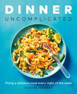 Cover image of Claire Tansey cookbook Dinner Uncomplicated showing a plate of noodles on a blue plate on a blue background