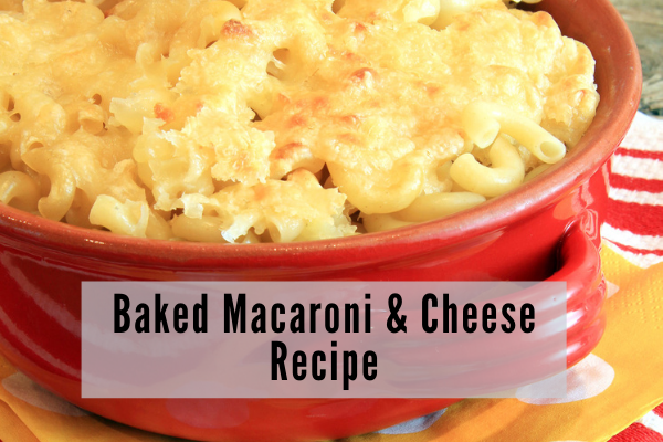 A red enamel dish filled with macaroni and cheese casserole with a toasted crunchy top