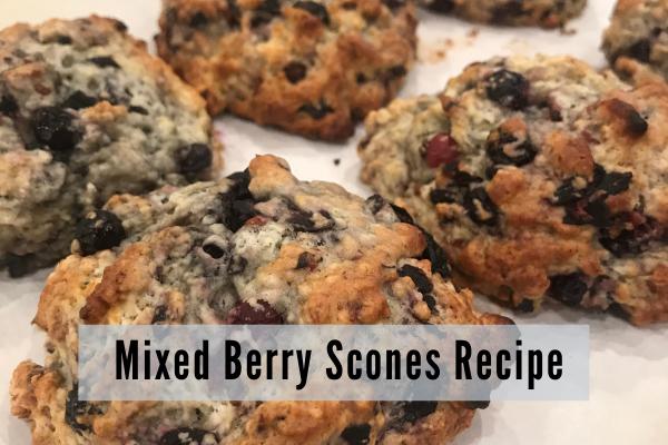 freshly baked golden brown scones with juicy blueberries
