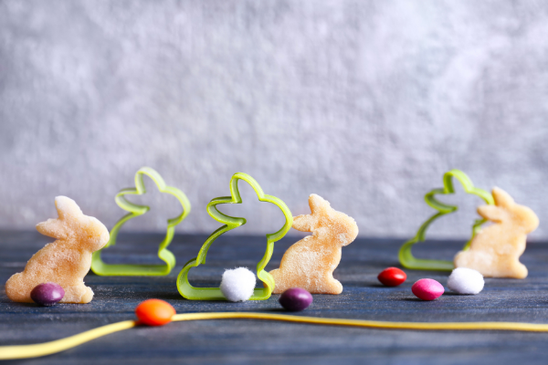 bunny cookie cutters and sandwich cutouts arranged like they are having a rice