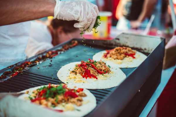 soft tacos cooking on an outdoor grill