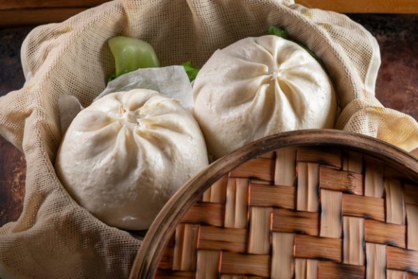 steamed chinese buns in a bamboo steamer