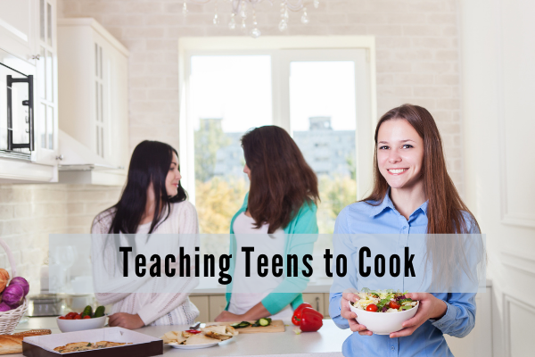 three young girls in a kitchen preparing salad