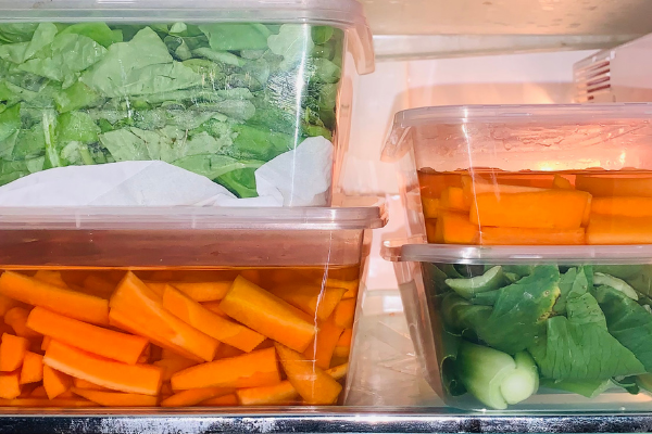 vegetables washed and cut and placed in the fridge in clear plastic containers
