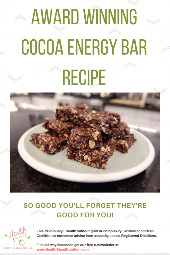 cocoa energy bars with nuts and rice krispies on a white plate