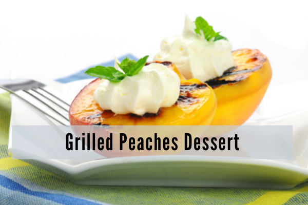 grilled peaches topped with ice cream and mint leaves