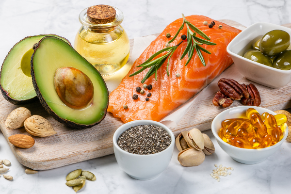healthy foods with unsaturated fats like salmon and avocado